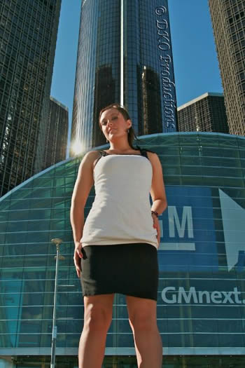 woman standing in front of GM Headquarters
